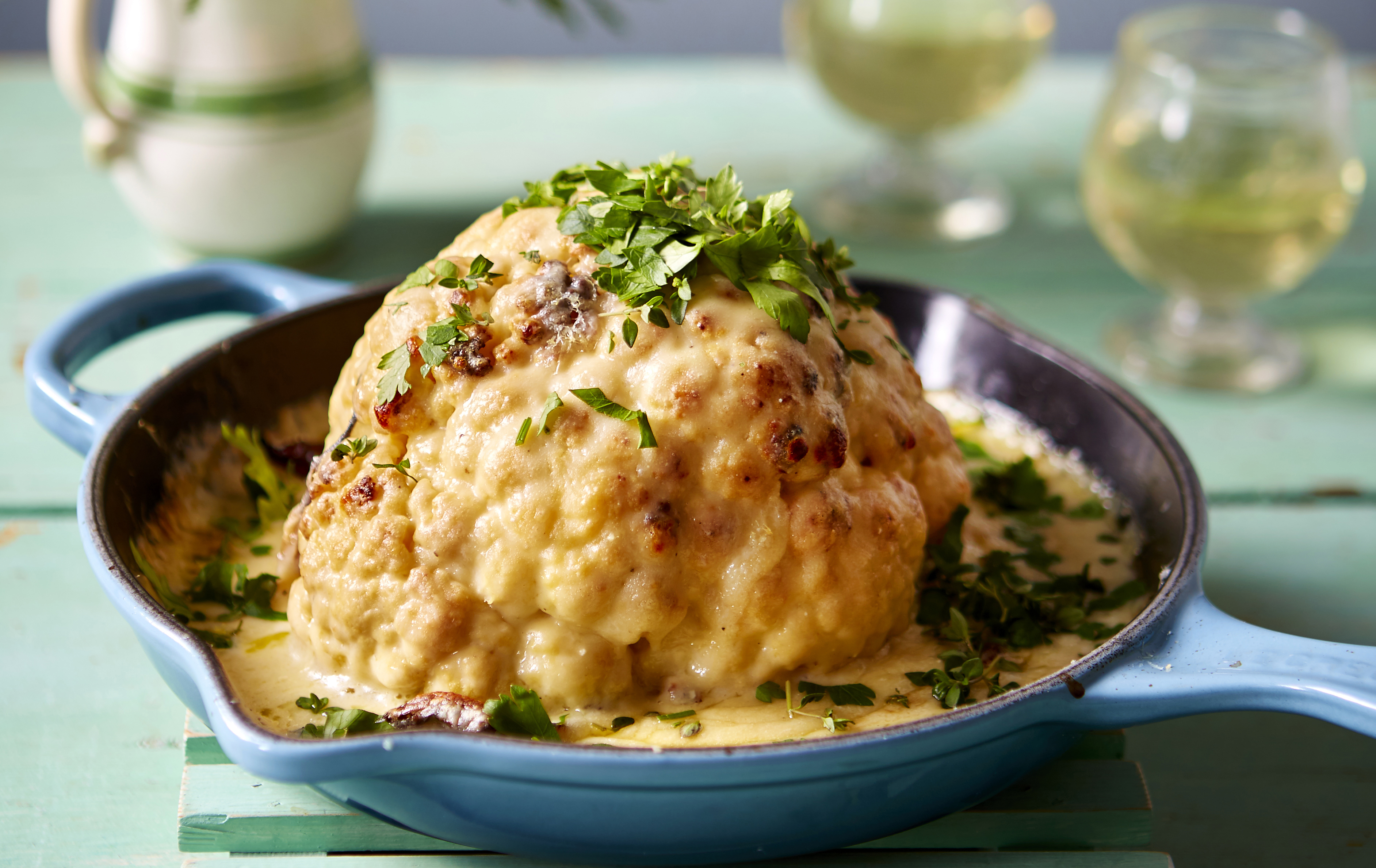 Whole roasted cauliflower with thyme and cheese sauce